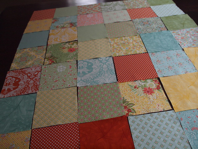 laying out the charm squares