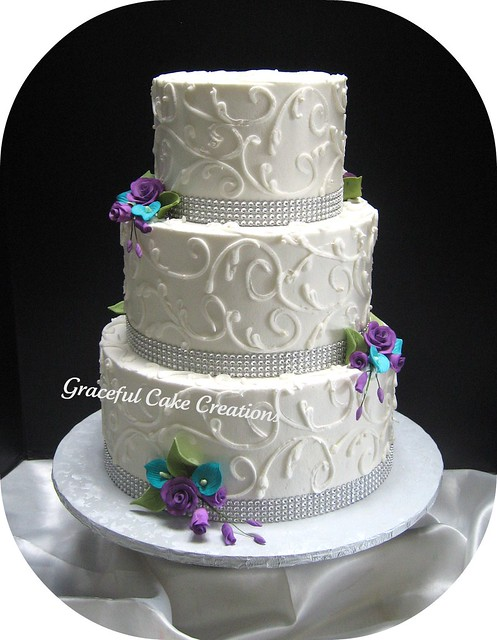 Elegant White Wedding Cake with Crystal Ribbon accented with Teal and Purple