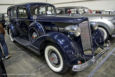 rolls-royce phantom iii(0.0), touring car(0.0), cadillac v-16(0.0), automobile(1.0), packard super eight(1.0), packard 120(1.0), vehicle(1.0), auto show(1.0), hot rod(1.0), antique car(1.0), vintage car(1.0), land vehicle(1.0), luxury vehicle(1.0), motor vehicle(1.0),