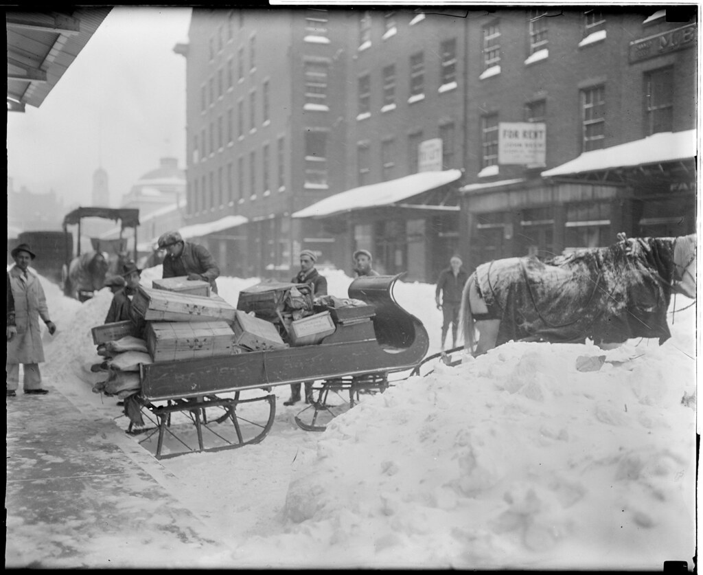 Horse-drawn sleigh for hauling goods, market district