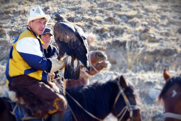 young men on horse with eagle