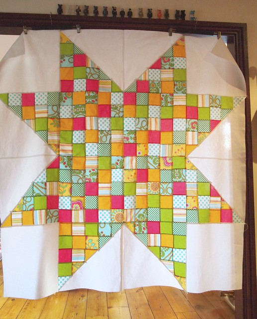 made in cherry quilt along top