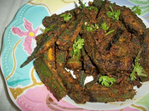 Rajasthani bhindi okra with spiced gramflour stuffing but now things have changed and everyone in my house loves ladysfingerma makes it like a simple poriyal always and i loved ite often make rasam and forumfinder Images