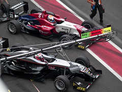 dirt track racing(0.0), pit stop(0.0), supercar(0.0), auto racing(1.0), automobile(1.0), automotive exterior(1.0), racing(1.0), sport venue(1.0), vehicle(1.0), sports(1.0), race(1.0), automotive design(1.0), open-wheel car(1.0), formula racing(1.0), motorsport(1.0), touring car(1.0), indycar series(1.0), formula one(1.0), formula one car(1.0), race track(1.0),