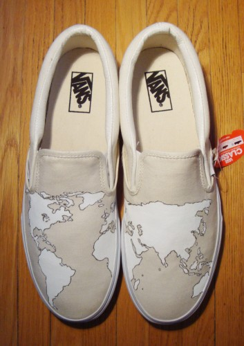 Eastern and western hemispheres hand-painted on custom vans