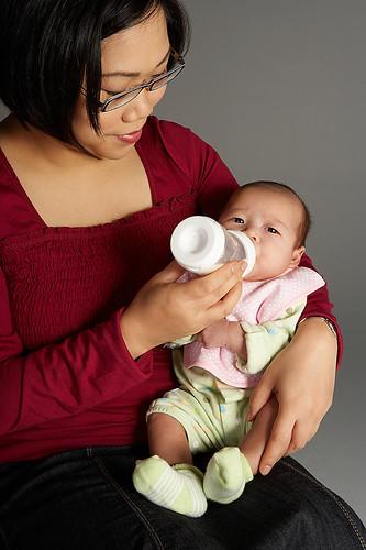 Mom feeding baby formula