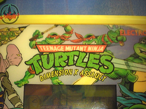 "TIGER ELECTRONICS :: ""TEENAGE MUTANT NINJA TURTLES: DIMENSION-X ASSAULT"" 'TALKING' ELECTRONIC LCD GAME  ix (( 1995 ))"