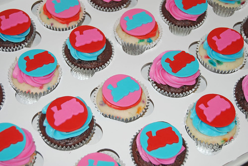 red, pink and aqua train cupcakes for a 4th birthday party