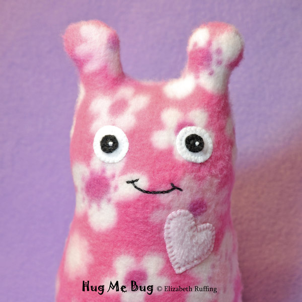 Pink flowered fleece Hug Me Bug, original art toy by Elizabeth Ruffing