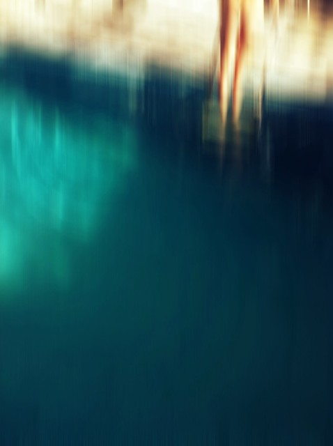 girl climbs from pool, blurred