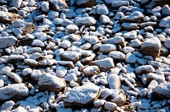 boulder(0.0), stone wall(0.0), rubble(0.0), cobblestone(0.0), stream bed(0.0), blue(0.0), geology(1.0), pebble(1.0), rock(1.0), gravel(1.0),