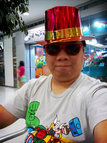 Me in megamall wearing the new year party hat by popazrael