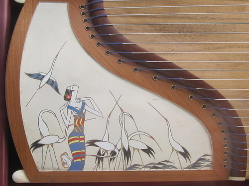 Woman with Cranes Painting on Chinese Instrument