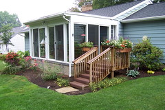 fence(0.0), shed(0.0), walkway(0.0), backyard(1.0), outdoor structure(1.0), garden(1.0), property(1.0), porch(1.0), yard(1.0), deck(1.0), cottage(1.0), siding(1.0), landscaping(1.0), real estate(1.0), lawn(1.0), home(1.0),