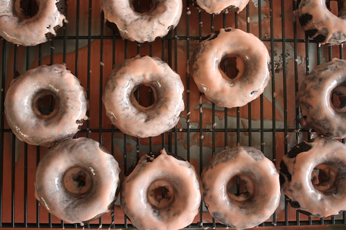 Chocolate donuts with blood orange glaze