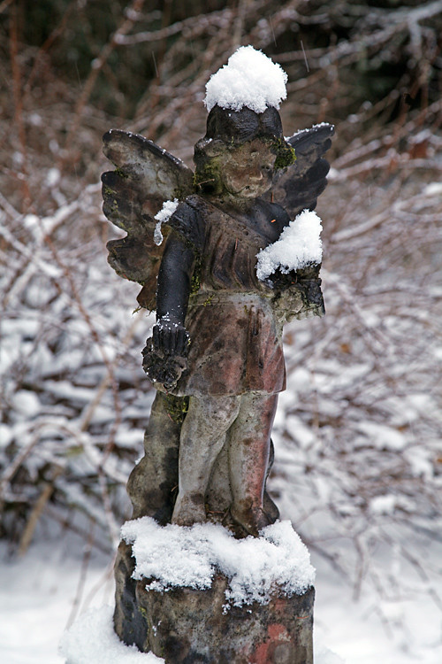 snow on angel headstone, Kasaan Cemetery, Kasaan, Alaska