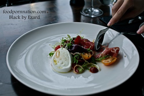 Heirloom tomato, basil sorbet, mozzarella, serrano jamon @ Black by Ezard