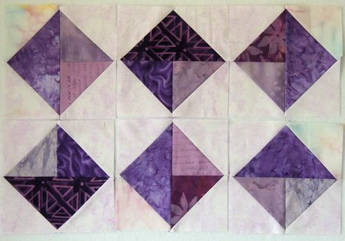 6 Scrappy Purple Triangles-in-a-Square blocks