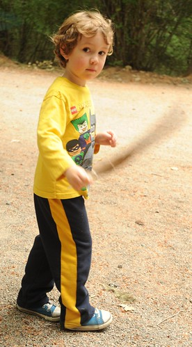 Light as a feather, a young superhero, in yellow lego Batman t-shirt, sports pants with a yellow stripe, and blue tennis shoes, Breitenbush Hot Springs, Breitenbush, Marion County, Oregon, USA by Wonderlane