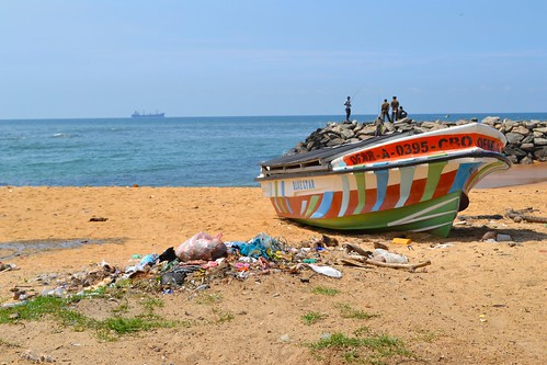 Fishing boat on the slum's shore