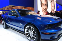 boss 302 mustang(0.0), automobile(1.0), wheel(1.0), vehicle(1.0), automotive design(1.0), rim(1.0), auto show(1.0), shelby mustang(1.0), full-size car(1.0), ford(1.0), land vehicle(1.0), muscle car(1.0), coupã©(1.0), sports car(1.0),