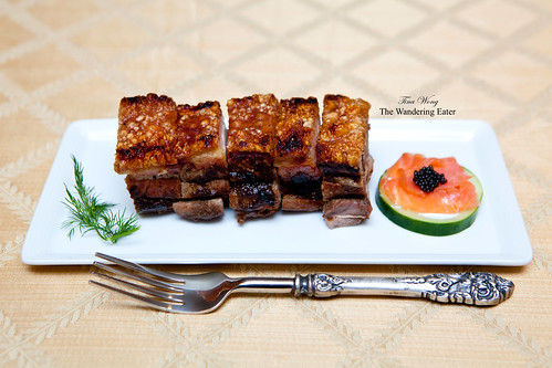 Homemade roast pork belly with a side of cucumber topped with Salmon Fume and Paddlefish caviar