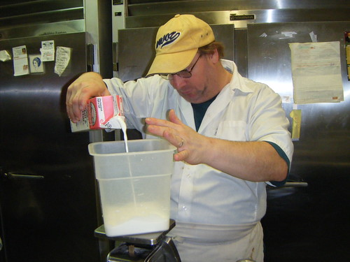 While the cakes cool on the baker's tray, Steve starts making the icing. photo by Briana Prevost