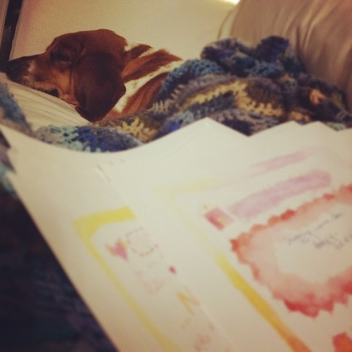 3. Snuggled in with pup while filling out @goddessleonie's planner for 2012