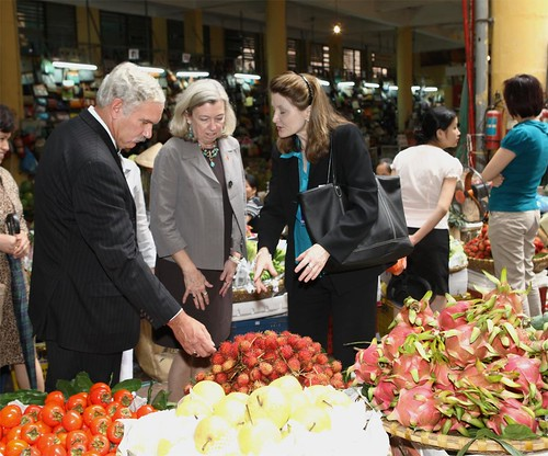 Acting Under Secretary for Farm and Foreign Agricultural Services Michael Scuse, tours the Hom Wet Market in Hanoi, Vietnam with Foreign Agricultural Service Acting Administrator Sue Heinen (center) and USDA's Agricultural Counselor to Vietnam Jeanne Bailey (right). There, they were able to see some Vietnam's local produce including rambutan and dragon fruit. This was one of many stops on the first-ever USDA agricultural trade mission to Vietnam, which Scuse led in Hanoi and Ho Chi Minh City Sep. 25-20, 2011 Photo By Le Nguyen-Binh