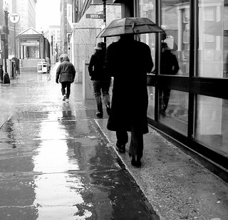 boston downtown crossing man with umbrella black white