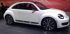 mid-size car(0.0), sedan(0.0), automobile(1.0), volkswagen beetle(1.0), automotive exterior(1.0), wheel(1.0), volkswagen(1.0), vehicle(1.0), automotive design(1.0), volkswagen new beetle(1.0), rim(1.0), subcompact car(1.0), city car(1.0), land vehicle(1.0), luxury vehicle(1.0), motor vehicle(1.0),