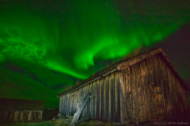 Old house and aurora borealis