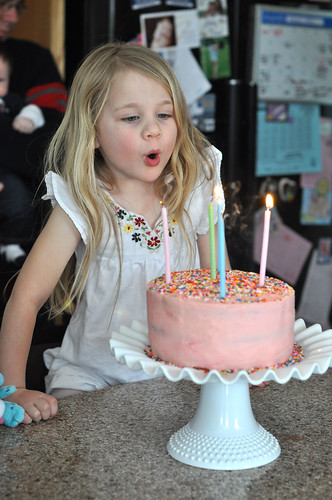 Bianca blowing out candles Jan 2012