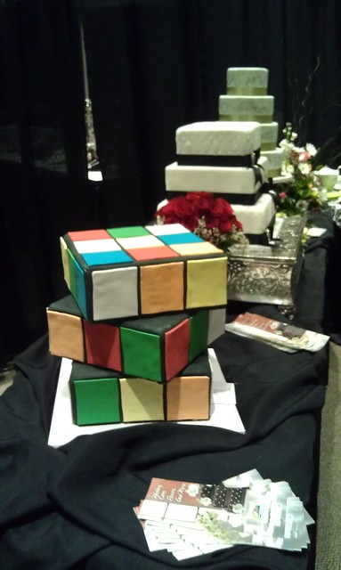 A Rubik's cube among wedding cakes