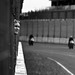 watching between the bars of the race track by w-anas