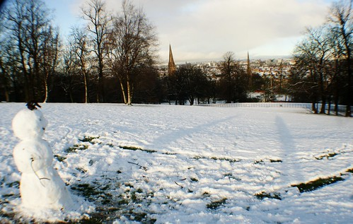 Snowman Viewing Glasgow from Queens Park