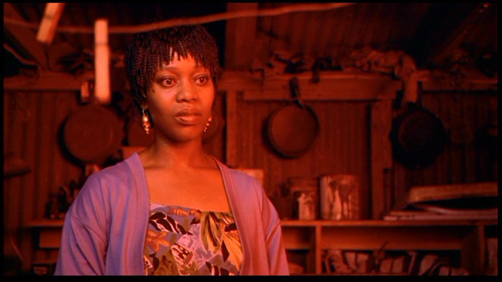 Chantelle, played by Alfre Woodard, standing and looking off camera to the right