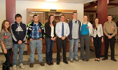 Education Commissioner Stephen Bowen poses with the eight students he met with at Bangor High School on Dec. 8, 2011.