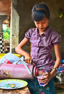 A young girl in Singaraja, Bali makes herself some noodles.