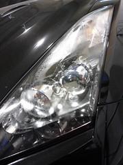 wheel(0.0), rim(0.0), mid-size car(0.0), grille(0.0), alloy wheel(0.0), bumper(0.0), automobile(1.0), automotive exterior(1.0), vehicle(1.0), automotive lighting(1.0), light(1.0), headlamp(1.0), land vehicle(1.0),