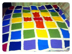 Knitted rainbow baby blanket.