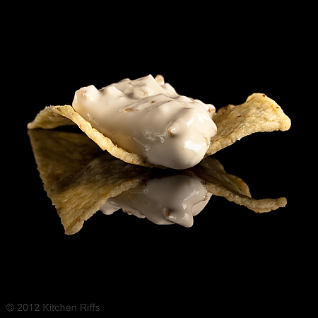 Clam Dip on Tortilla Chip on Black Acrylic