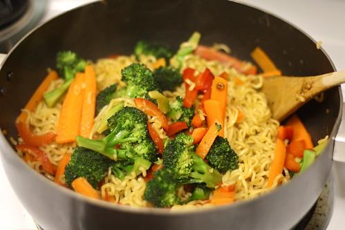 Stir veggies into noodle