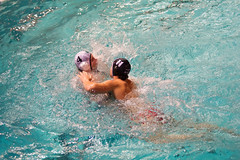 individual sports(0.0), freestyle swimming(0.0), water & ball sports(1.0), water polo(1.0), swimming(1.0), sports(1.0), recreation(1.0), outdoor recreation(1.0), wind wave(1.0), swimmer(1.0), water sport(1.0),