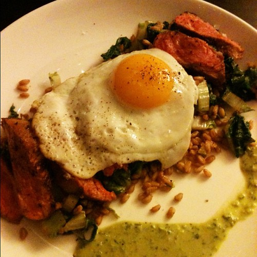 Seared pork skirt steak, farro, baby napa cabbage, anchovy-herb sauce, olive oil fried egg