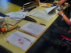 """At Work 2.4.2014: """"My"""" place at the Table and besides me the Costume Designer is doing her work: Folding Paper-Hats ~ Drawing: """"Büste Kaiser Franz Josef I., Kopf aufgespießt, Gewehre mit Tüllenbajonetten - Rehearsal """"Die letzten Tage der Menschheit"""""""