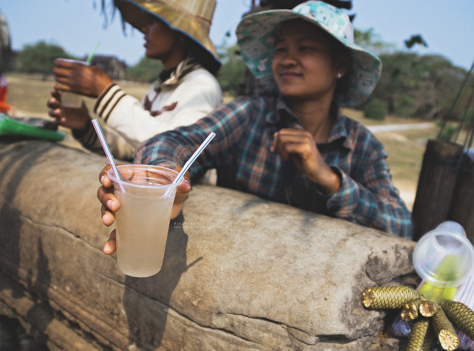 Palm juice handed over by this sweet girl