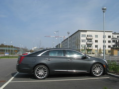 automobile(1.0), executive car(1.0), family car(1.0), wheel(1.0), vehicle(1.0), cadillac xts(1.0), full-size car(1.0), mid-size car(1.0), sedan(1.0), land vehicle(1.0), luxury vehicle(1.0),