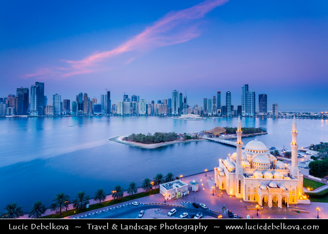 United Arab Emirates - UAE - Emirate of Sharjah - Cityscape around Khaled lagoon at Buhaira Corniche & Al Noor Mosque at Dusk - Twilight - Blue Hour - Night