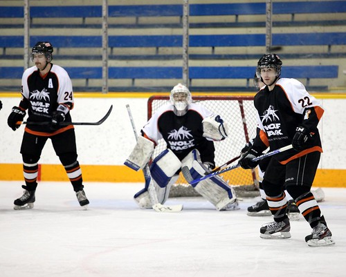 Shane Mainprize waiting for puck with Cody Lockwood and Curtis Tonello beside him (horizontal Dec 3, 2011 Allan Douglas)